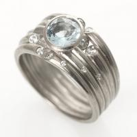 Ice ring in white gold with diamonds & center aquamarine