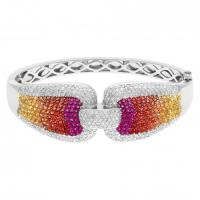 Gorgeous multi colored sapphire, diamond, and ruby bangle in 18k white gold