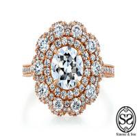 the camelllia: custom flower halo rose gold engagement ring