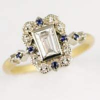 Limited Collection Two Tone Ribbon Frame Ring in 18K yellow and white gold with tapered baguette diamond