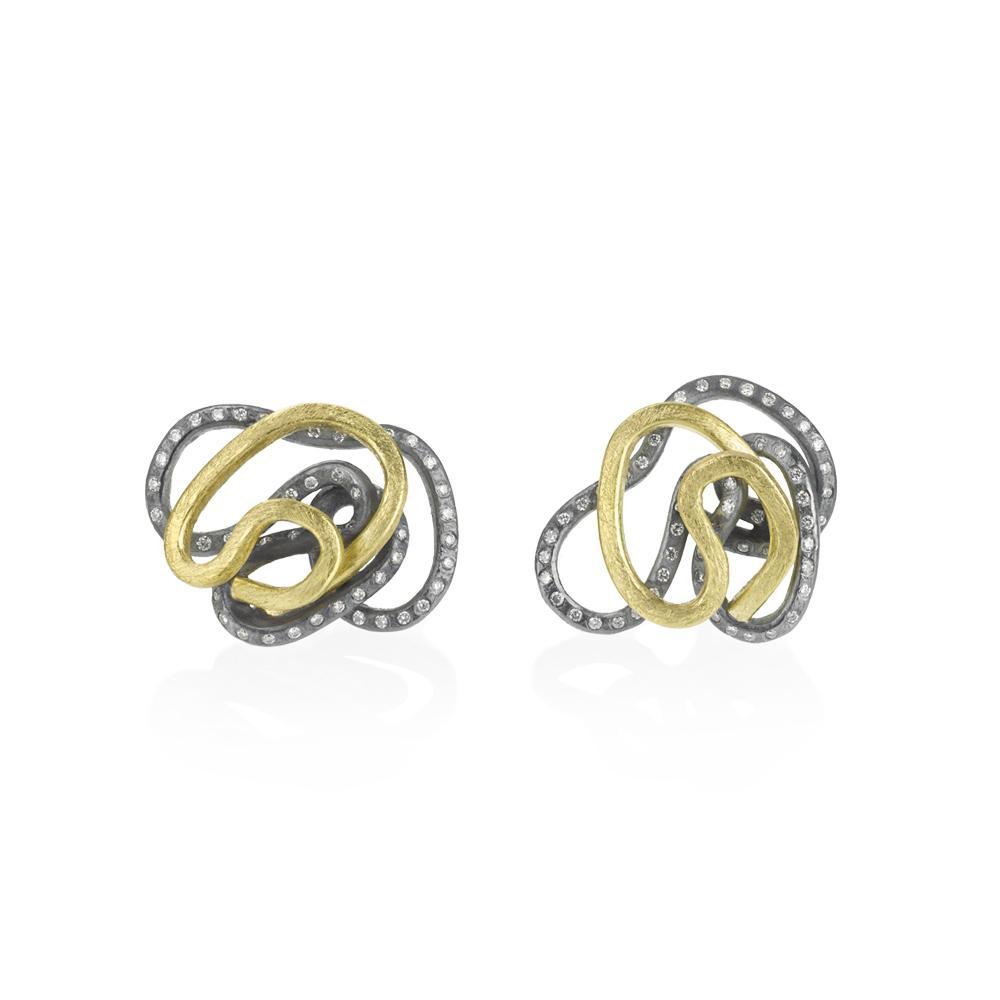 Swirl stud earrings with white brilliant cut diam