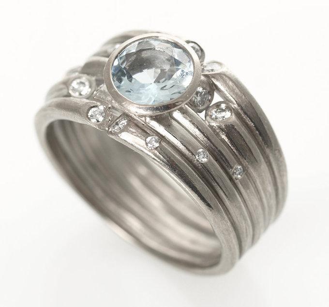 ice ring in white gold with diamonds & center aquamarine
