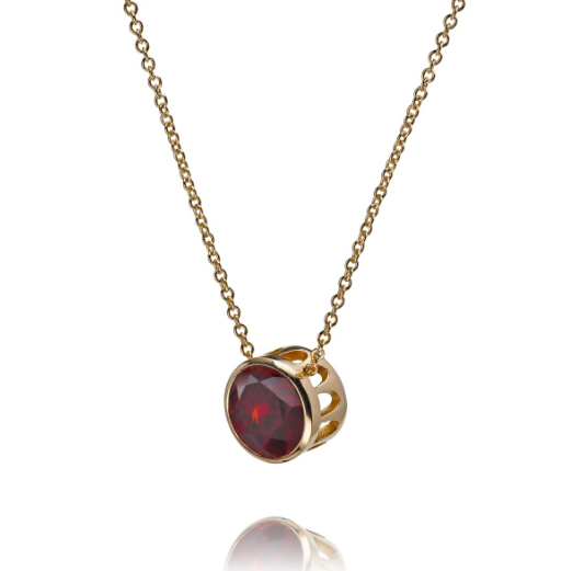 Eco gold and garnet comet pendant necklace
