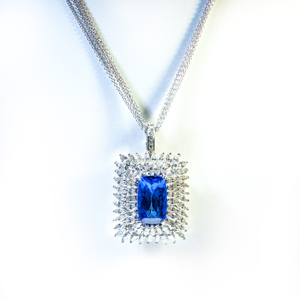 platinum tanzanite surrounded by marquise diamonds pendant on quadruple 14k white gold chain