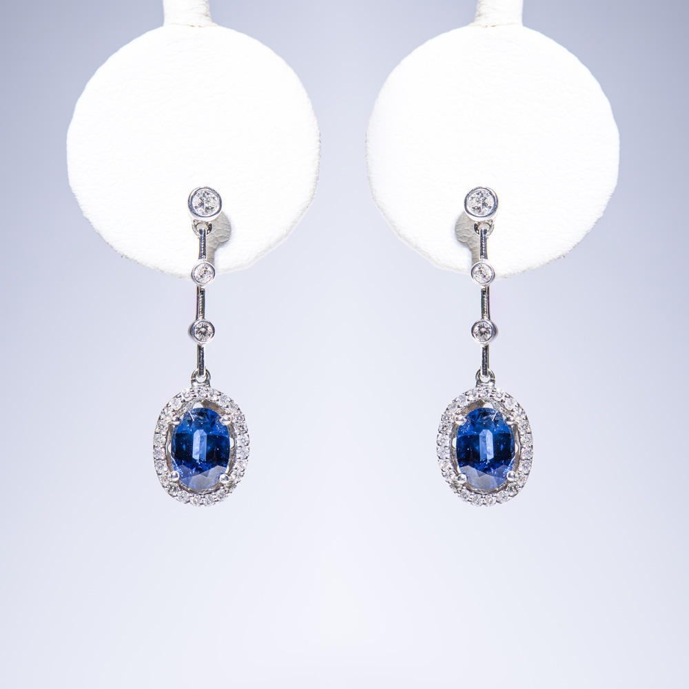 18k white gold oval blue sapphire in diamond halo hanging earrings