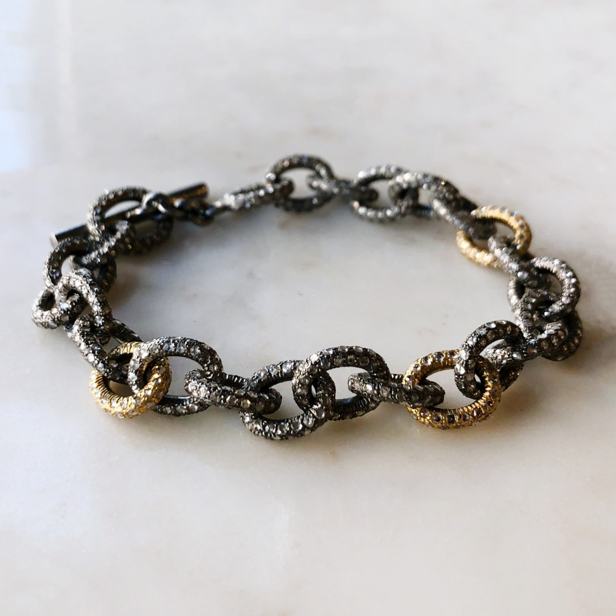 silver and gold diamond link bracelet